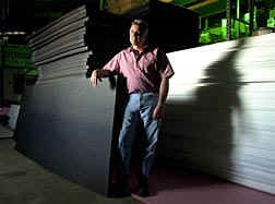 Mike Bell, owner of Creative Packaging Inc., uses the polyethylene foam stacked behind him to make a variety of custom packaging products